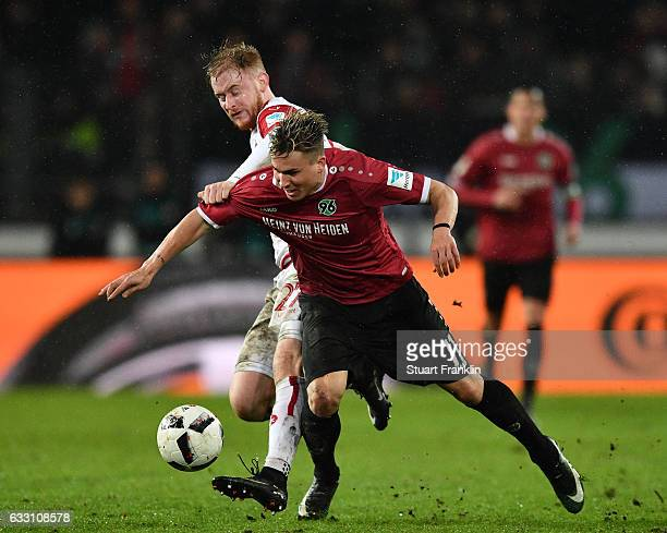 Felix Klaus of Hannover is challenged by Sebastian Kerk of Kaiserslautern during the Second Bundesliga match between Hannover 96 and 1 FC...