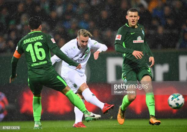 Felix Klaus of Hannover is challenged by Zlatko Junuzovic f Bremen during the Bundesliga match between SV Werder Bremen and Hannover 96 at...
