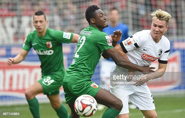 Felix Klaus of SC Freiburg challenges Abdul Rahman Baba of FC Augsburg during the Bundesliga match between SC Freiburg and FC Augsburg at...