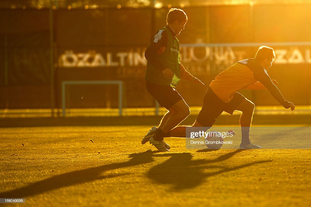 Felix Kroos and Sokratis of Bremen battle for the ball during a training session at day six of the Werder Bremen Training Camp on January 10, 2013 in Belek, Turkey.