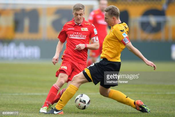 Felix Kroos of 1 FC Union Berlin and Marco Hartmann of SG Dynamo Dresden during the game between SG Dynamo Dresden and dem 1 FC Union Berlin on...