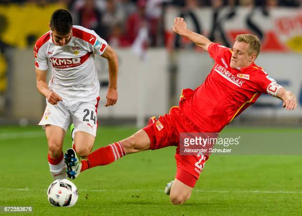 Felix Kroos of Berlin challenges Josip Brekalo of Stuttgart during the Second Bundesliga match between VfB Stuttgart and 1 FC Union Berlin at...
