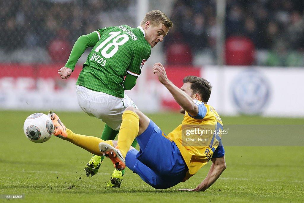 Felix Kroos of Bremen and Ken Reichel of Braunschweig compete for the ball during the Bundesliga match between Werder Bremen and Eintracht...