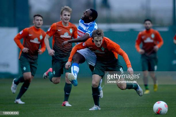 Felix Kroos of Bremen and Ricardo Talu of Zwolle battle for the ball during a friendly match between Werder Bremen and PEC Zwolle on January 11 2013...