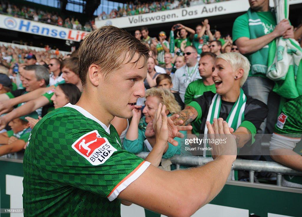 Felix Kroos of Bremen celebrates with fans after the Bundesliga match between Werder Bremen and FC Augsburg at Weserstadion on August 17 2013 in...