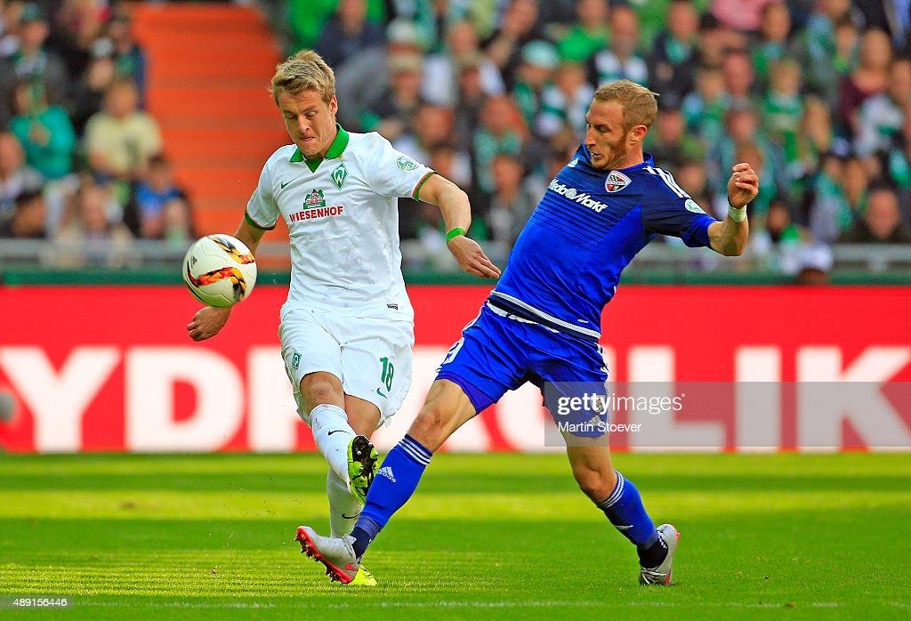 Felix Kroos of Bremen challenges Moritz Hartmann of Ingolstadt during the Bundesliga match between Werder Bremen and FC Ingolstadt at Weserstadion on...