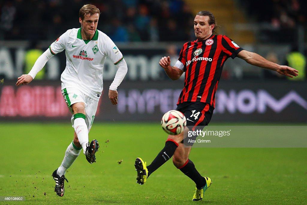 Felix Kroos of Bremen is challenged by Alexander Meier of Frankfurt during the Bundesliga match between Eintracht Frankfurt and SV Werder Bremen at...