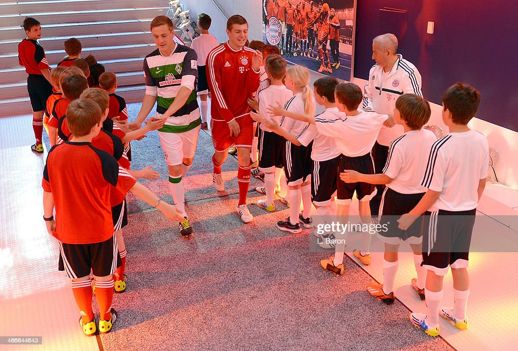 Felix Kroos of Bremen is seen with his brother Toni Kroos of Muenchen prior to the Bundesliga match between Bayern Muenchen and Werder Bremen at...
