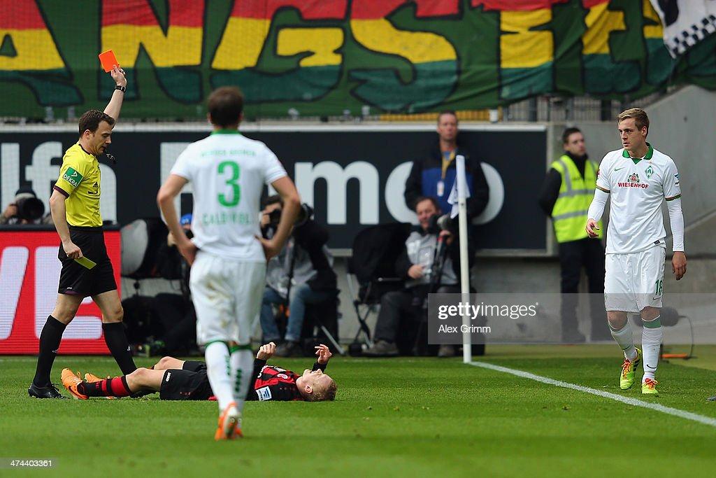 Felix Kroos of Bremen is sent off by referee Felix Zwayer during the Bundesliga match between Eintracht Frankfurt and Werder Bremen at Commerzbank...