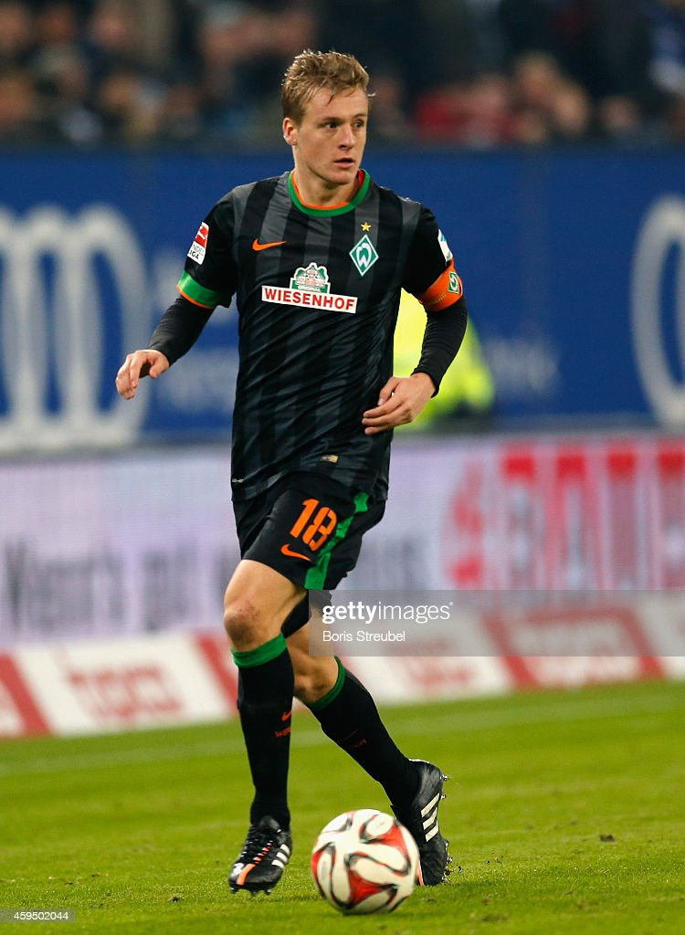 Felix Kroos of Bremen runs with the ball during the Bundesliga match between Hamburger SV and SV Werder Bremen at Imtech Arena on November 23 2014 in...