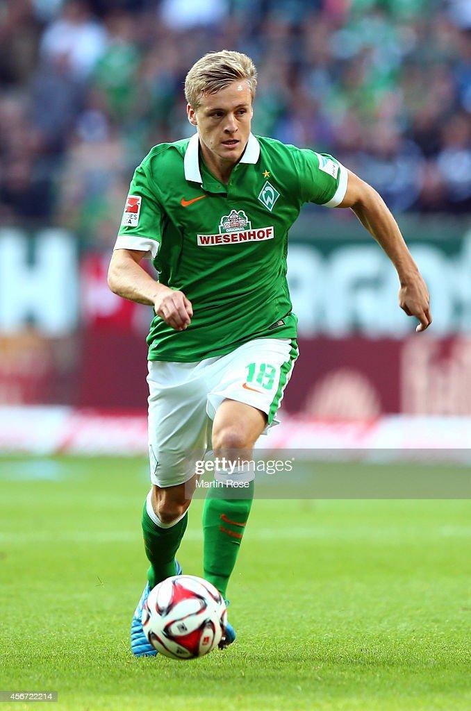 Felix Kroos of Bremen runs with theball during the Bundesliga match between SV Werder Bremen and SC Freiburg at Weserstadion on October 4 2014 in...