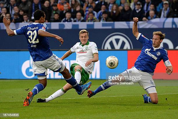 Felix Kroos of Bremen scores his team's opening goal during the Bundesliga match between FC Schalke 04 and Werder Bremen at VeltinsArena on November...