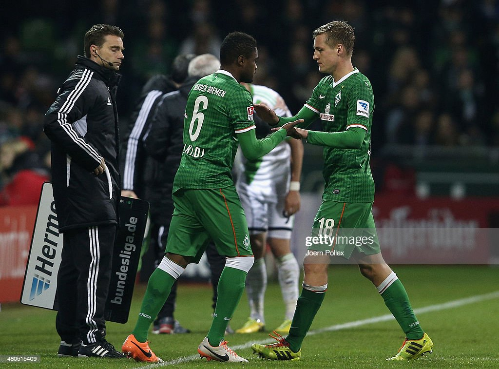 Felix Kroos of Bremen shakes hands with Cedrick Makiadi of Bremen during a substitution during the Bundesliga match between Werder Bremen and VfL...