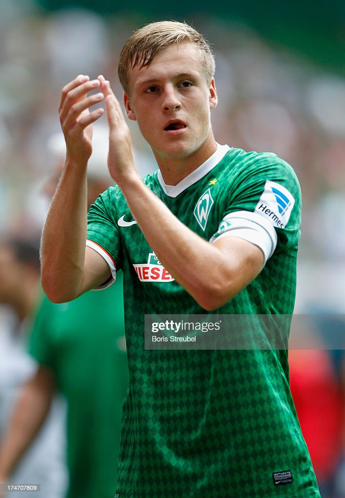 Felix Kroos of Bremen waves to the fans during the preseason friendly match between Werder Bremen and Fulham at Weser Stadium on July 28 2013 in...