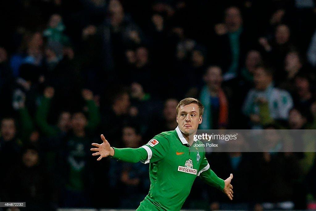 Felix Kroos of Brmene celebrates after scoring his team's third goal during the Bundesliga match between SV Werder Bremen and VfL Wolfsburg at...