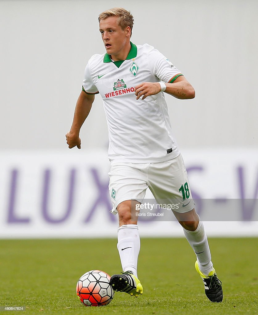 Felix Kroos of Werder Bremen runs with the ball during the friendly match between Hansa Rostock and SV Werder Bremen at DKBArena on July 7 2015 in...