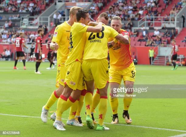 Felix Kroos Steven Skrzybski Christopher Trimmel Marcel Hartel and Sebastian Polter of 1FC Union Berlin celebrate after scoring the 01 during the...