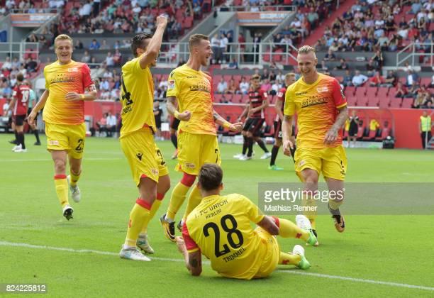 Felix Kroos Steven Skrzybski Marcel Hartel Christopher Trimmel and Sebastian Polter of 1FC Union Berlin celebrate after scoring the 01 during the...