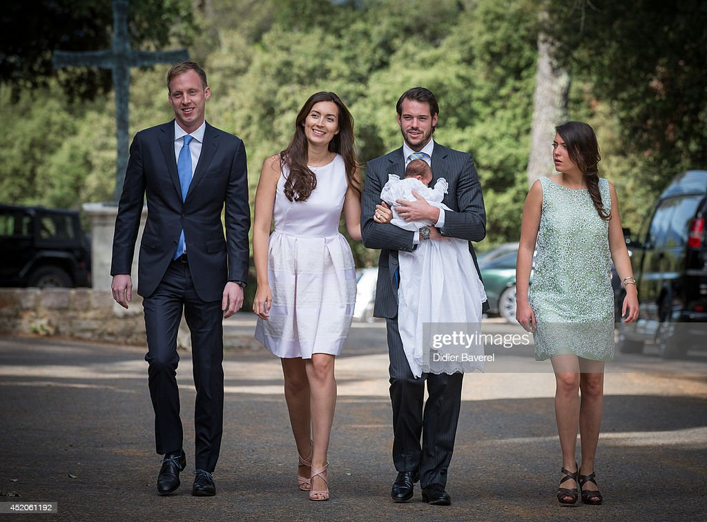 Felix Lademacher, Princess Claire of Luxembourg, Prince Felix of Luxembourg and Princess Alexandra of Luxembourg pose with their daughter Princess Amalia of Luxembourg before her Christening ceremony, at the Saint Ferreol Chapel in Lorgues on July 12, 2014 in Lorgues, France.