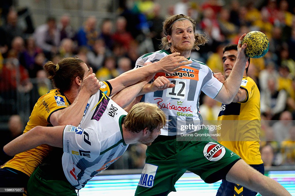 Felix Lobedank and <a gi-track='captionPersonalityLinkClicked' href=/galleries/search?phrase=Manuel+Spaeth&family=editorial&specificpeople=4080840 ng-click='$event.stopPropagation()'>Manuel Spaeth</a> of Goeppingen are challenged by Kim Ekdahl du Rietz and <a gi-track='captionPersonalityLinkClicked' href=/galleries/search?phrase=Zarko+Sesum&family=editorial&specificpeople=5668700 ng-click='$event.stopPropagation()'>Zarko Sesum</a> of Rhein-Neckar Loewen during the DKB Handball Bundesliga match between Rhein-Neckar Loewen and Frisch Auf Goeppingen at SAP Arena on December 22, 2012 in Mannheim, Germany.