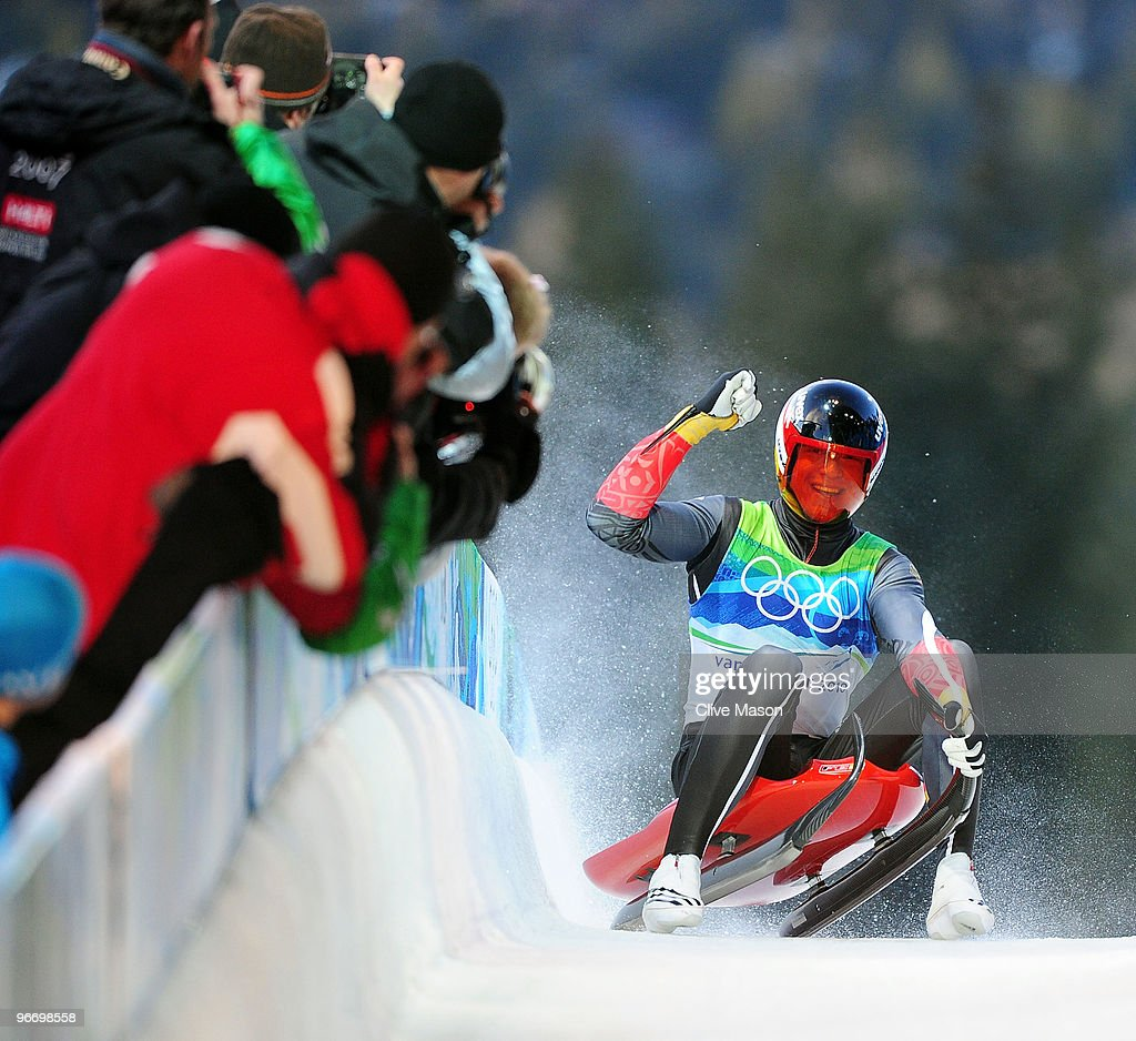 Felix Loch of Germany celebrates winning the gold medal after finishing the final run of the men's luge singles final on day 3 of the 2010 Winter Olympics at Whistler Sliding Centre on February 14, 2010 in Whistler, Canada.