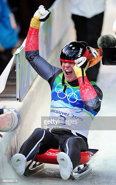 Felix Loch of Germany celebrates winning the gold medal after finishing the final run of the men's luge singles final on day 3 of the 2010 Winter...