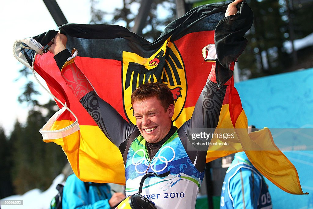 Felix Loch of Germany celebrates winning the gold medal after the final run of the men's luge singles final on day 3 of the 2010 Winter Olympics at Whistler Sliding Centre on February 14, 2010 in Whistler, Canada.