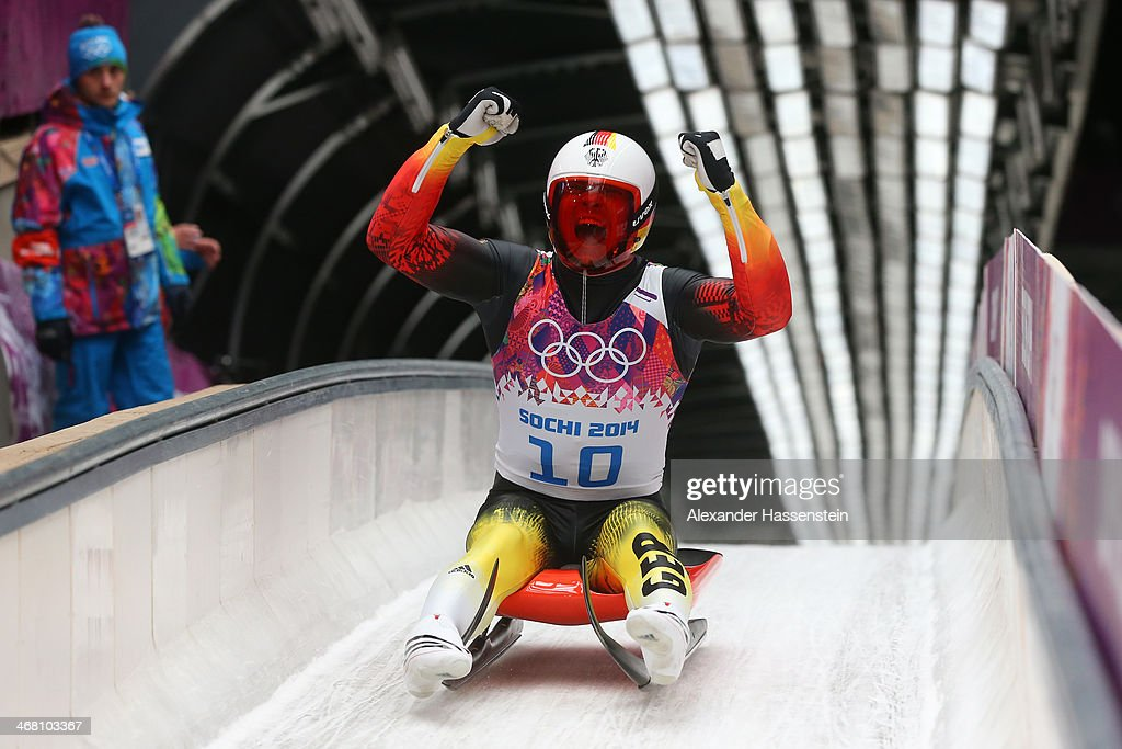 Felix Loch of Germany celebrates winning the gold medal during the Men's Luge Singles on Day 2 of the Sochi 2014 Winter Olympics at Sliding Center...