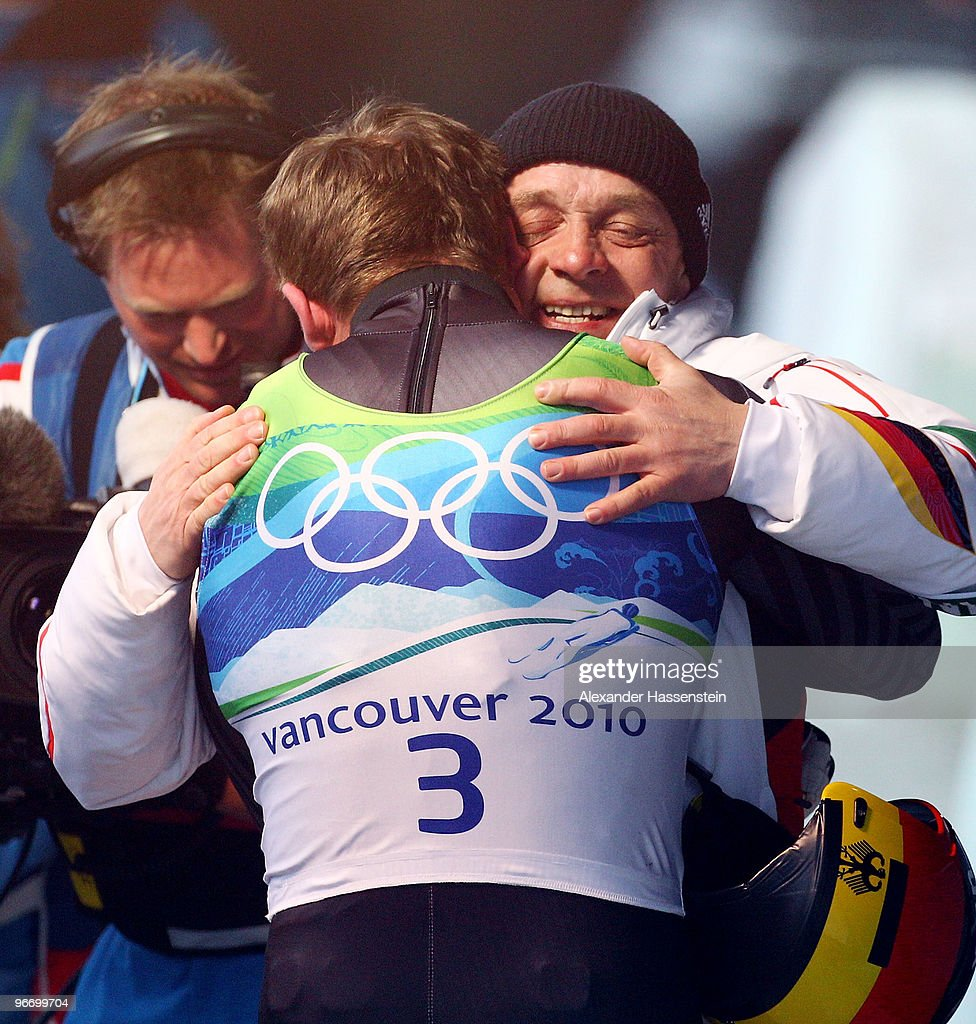 <a gi-track='captionPersonalityLinkClicked' href=/galleries/search?phrase=Felix+Loch&family=editorial&specificpeople=4840944 ng-click='$event.stopPropagation()'>Felix Loch</a> of Germany is congratulated by his father <a gi-track='captionPersonalityLinkClicked' href=/galleries/search?phrase=Norbert+Loch&family=editorial&specificpeople=5622328 ng-click='$event.stopPropagation()'>Norbert Loch</a> after winning the gold medal after the final run of the men's luge singles final on day 3 of the 2010 Winter Olympics at Whistler Sliding Centre on February 14, 2010 in Whistler, Canada.