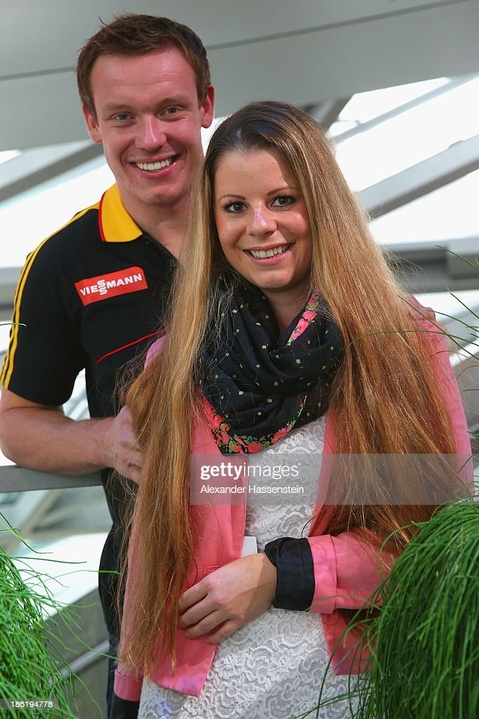Felix Loch poses with Lisa Ressle after the season opening press conference of the German Bobsleigh and Skeleton federation at BMW Welt on October 29, 2013 in Munich, Germany.
