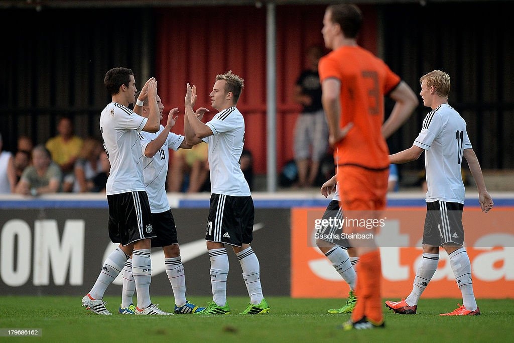 Felix Lohkemper (C) from Germany celebrates after scoring his team's 5th goal with team matesduring the U19 international friendly match between The Netherlands and Germany on September 6, 2013 in Nijmegen, Netherlands.