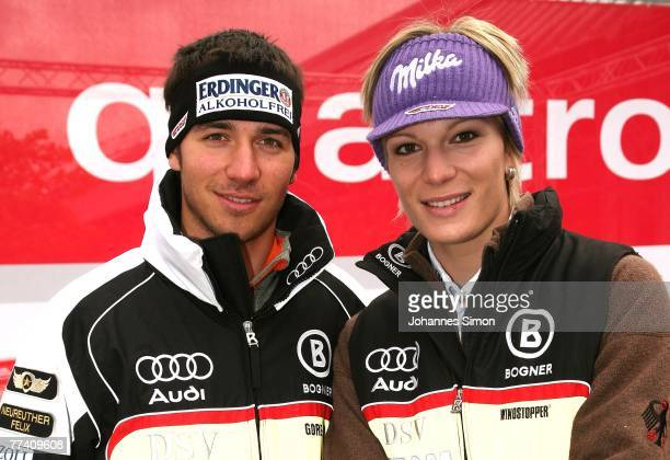 Felix Neureuther and Maria Rieschalpine skier of the DSV German Ski Association pose in front of an Audi Quattro car after a press conference at Audi...