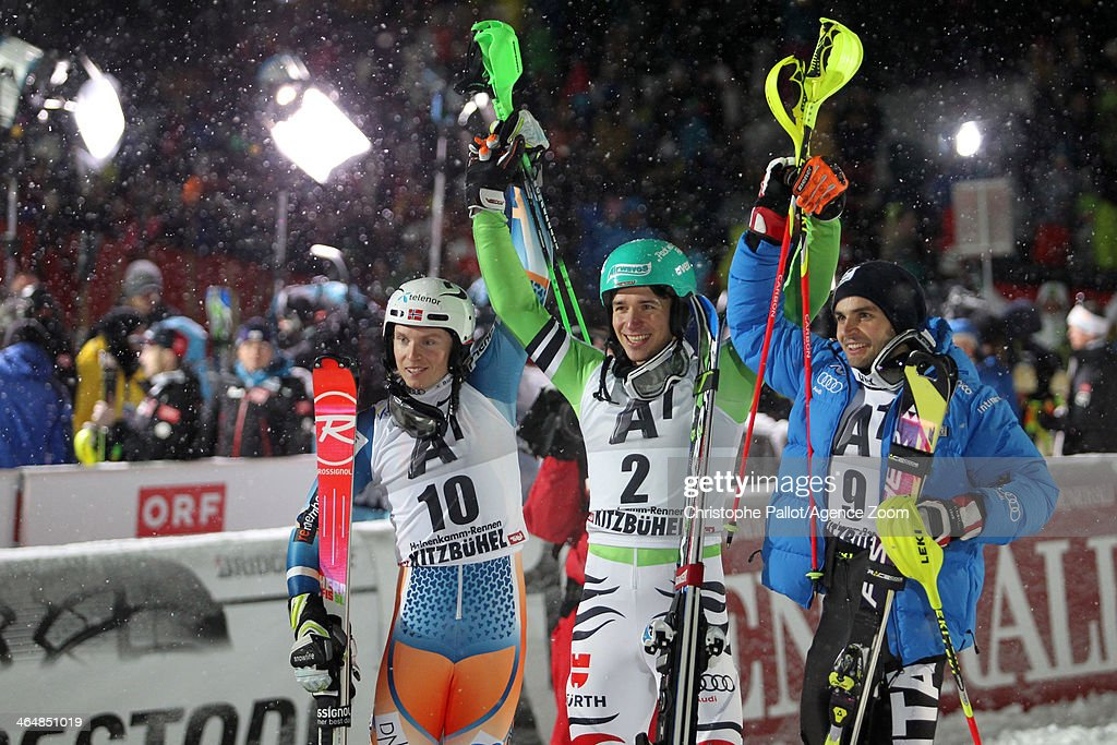 <a gi-track='captionPersonalityLinkClicked' href=/galleries/search?phrase=Felix+Neureuther&family=editorial&specificpeople=807800 ng-click='$event.stopPropagation()'>Felix Neureuther</a> of Germany takes 1st place, <a gi-track='captionPersonalityLinkClicked' href=/galleries/search?phrase=Henrik+Kristoffersen&family=editorial&specificpeople=9010050 ng-click='$event.stopPropagation()'>Henrik Kristoffersen</a> of Norway takes 2nd place, <a gi-track='captionPersonalityLinkClicked' href=/galleries/search?phrase=Patrick+Thaler&family=editorial&specificpeople=807782 ng-click='$event.stopPropagation()'>Patrick Thaler</a> of Italy takes 3rd place during the Audi FIS Alpine Ski World Cup Men's Slalom on January 24, 2014 in Kitzbuehel, Austria.
