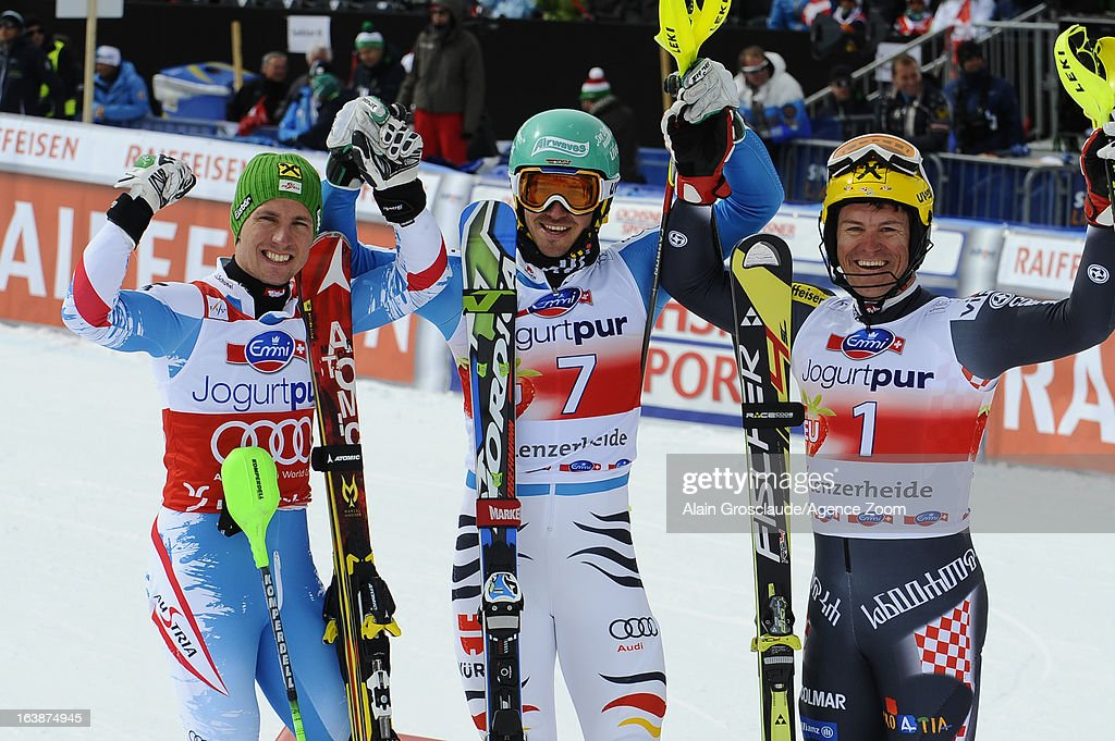 Felix Neureuther of Germany takes 1st place, Marcel Hirscher of Austria takes 2nd place and Ivica Kostelic of Croatia takes 3rd place during the Audi FIS Alpine Ski World Cup Men's Slalom on March 17, 2013 in Lenzerheide, Switzerland.