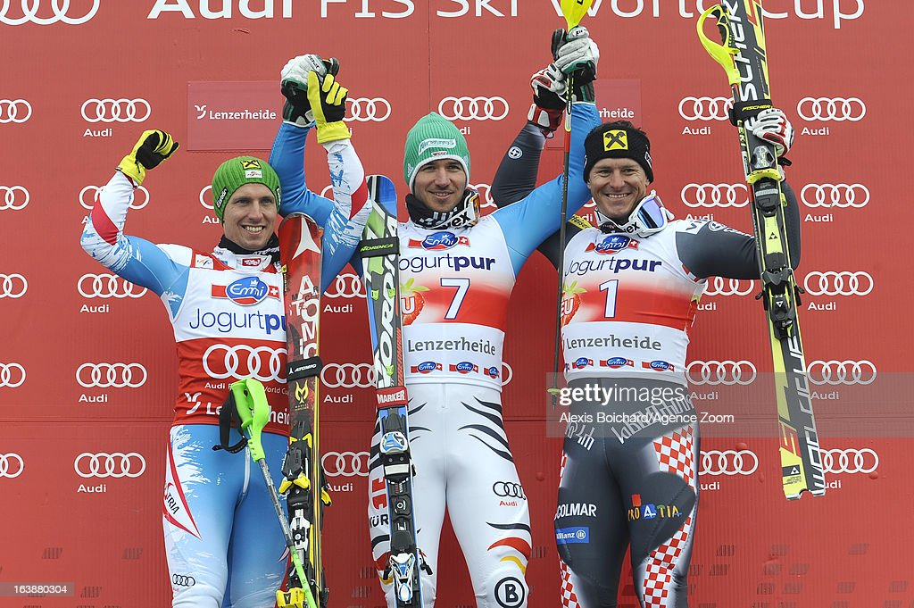 Felix Neureuther of Germany takes 1st place, Marcel Hirscher of Austria takes 2nd place,Ivica Kostelic of Croatia takes 3rd place during the Audi FIS Alpine Ski World Cup Men's Slalom on March 17, 2013 in Lenzerheide, Switzerland.
