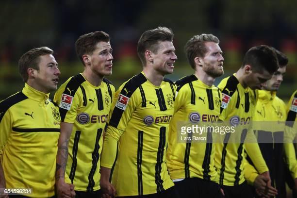 Felix Passlack Erik Durm Lukas Piszczek Andre Schuerrle and Julian Weigl of Dortmund celebrate with the fans after the Bundesliga match between...