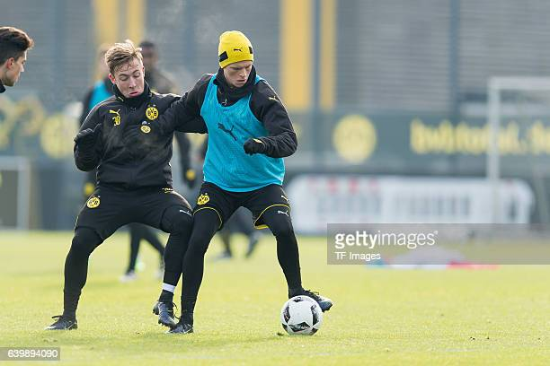 Felix Passlack of Borussia Dortmund and Dzenis Burnic of Borussia Dortmund battle for the ball during a training session at the BVB Training center...