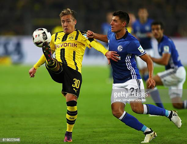 Felix Passlack of Borussia Dortmund battles for the ball with Alessandro Schopf of Schalke during the Bundesliga match between Borussia Dortmund and...