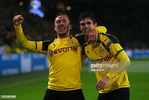Felix Passlack of Borussia Dortmund celebrates scoring his teams seventh goal with teammate Christian Pulisic during the UEFA Champions League Group...