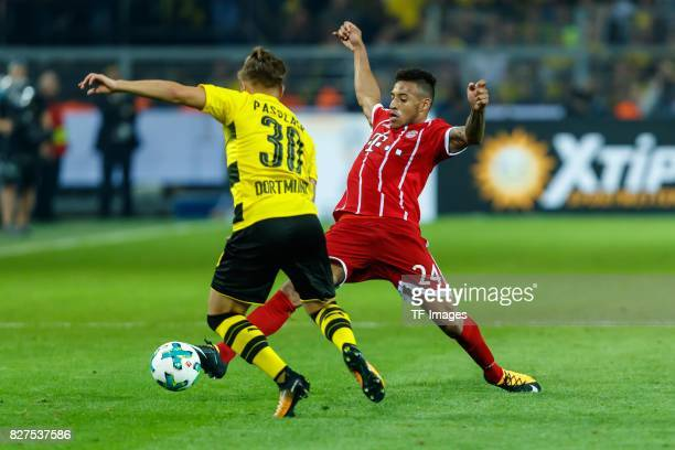 Felix Passlack of Dortmund and Corentin Tolisso of Bayern Muenchen battle for the ball during the DFL Supercup 2017 match between Borussia Dortmund...