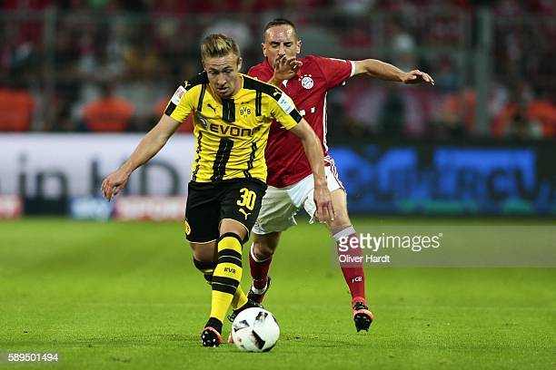 Felix Passlack of Dortmund and Franck Ribery of Munich compete for the ball during DFL Supercup 2016 match between Borussia Dortmund and FC Bayern...