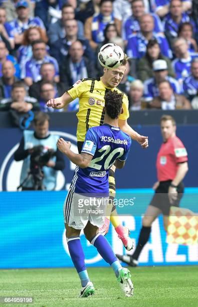 Felix Passlack of Dortmund and Thilo Kehrer of Schalke battle for the ball during the Bundesliga match between FC Schalke 04 and Borussia Dortmund at...