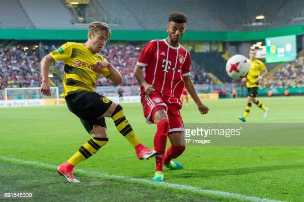Felix Passlack of Dortmund and Timothy Tillman of Munich battle for the ball during the U19 German Championship Final match between U19 Borussia...