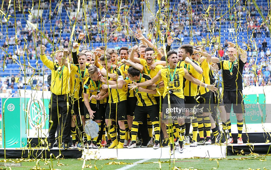 <a gi-track='captionPersonalityLinkClicked' href=/galleries/search?phrase=Felix+Passlack&family=editorial&specificpeople=12337670 ng-click='$event.stopPropagation()'>Felix Passlack</a> of Dortmund drops the trophy as team mates of Dortmund celebrate after the A Juniors German Championship Final match between 1899 Hoffenheim U19 and Borussia Dortmund U19 at Wirsol Rhein-Neckar-Arena on May 29, 2016 in Sinsheim, Germany.