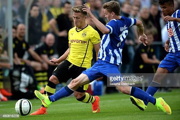 Felix Passlack of Dortmund is challenged by Nils Blumberg of Hertha BSC during the B juniors bundesliga semi final match between Borussia Dortmund...