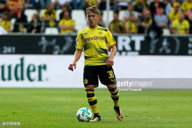 Felix Passlack of Dortmund runs with the ball during the preseason friendly match between RotWeiss Essen and Borussia Dortmund at Stadion Essen on...