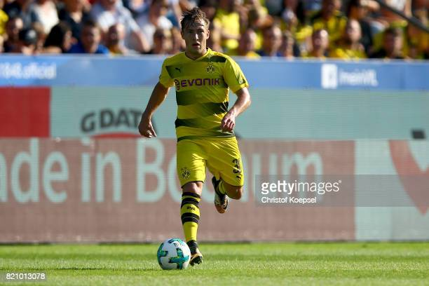 Felix Passlack of Dortmund runs with the ball during the preseason friendly match between VfL Bochum and Borussia Dortmund at Vonovia Ruhrstadion on...