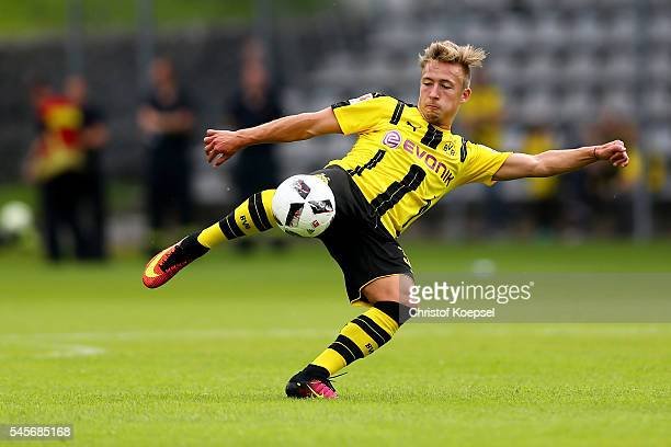 Felix Passlack of Dortmund shoots the ball during the friendly match between Wuppertaler SV and Borussia Dortmund at Stadion Zoo on July 9 2016 in...