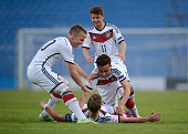 Felix Passlack of Germany celebrates with teammates after scoring against Belgium during the UEFA European Under17 Championship Final tournament...