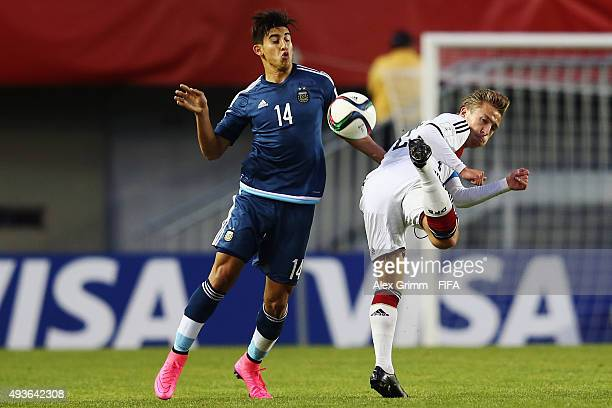 Felix Passlack of Germany is challenged by Tiago Ruiz Diaz of Argentina during the FIFA U17 World Cup Chile 2015 Group C match between Argentina and...